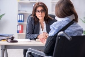 Injured employee visiting lawyer for advice on insurance